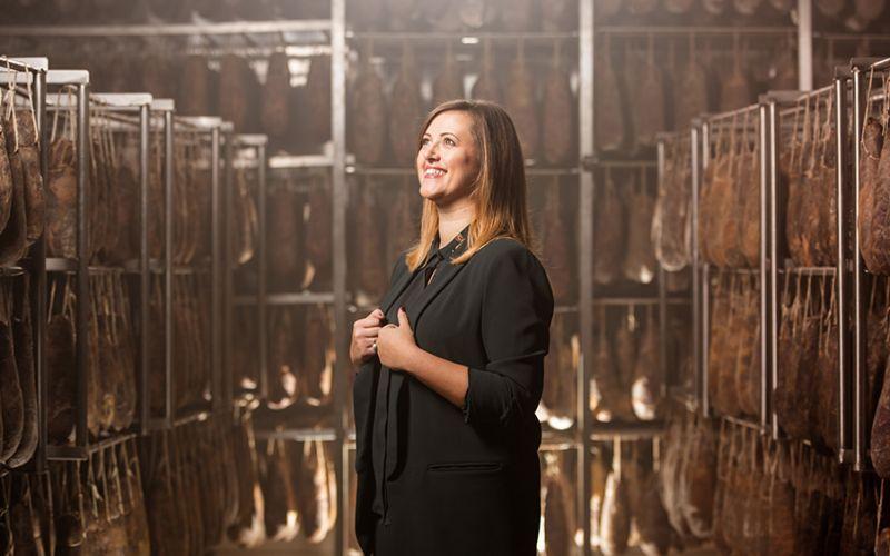 Photo portrait of Angela Santoro in the production center of the salumificio